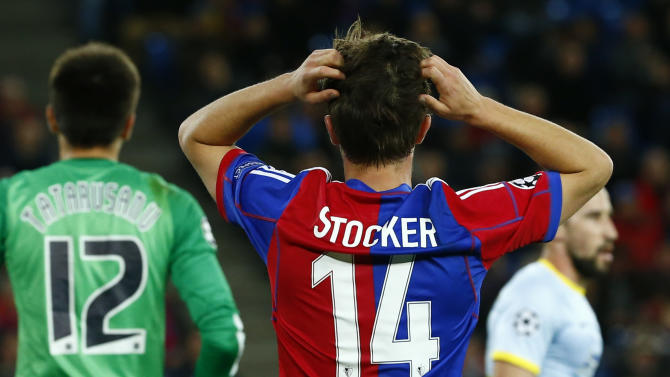 FC Basel's Stocker reacts after missing a chance to score against Steaua Bucharest during Champions League soccer match in Basel