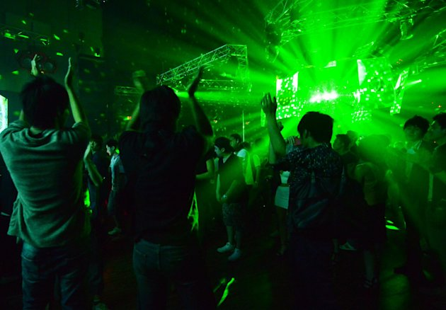 Dancing after midnight in Tokyo will no longer be illegal, as long as it's not too dark. (AFP Photo/Yoshikazu Tsuno)