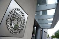 """The logo of the International Monetary Fund (IMF) at the organization's headquarters in Washington, DC. Teh IMF looks set to receive the $400 billion it needs to boost a """"global firewall"""" and help stem Europe's debt crisis, Japan's finance minister said"""