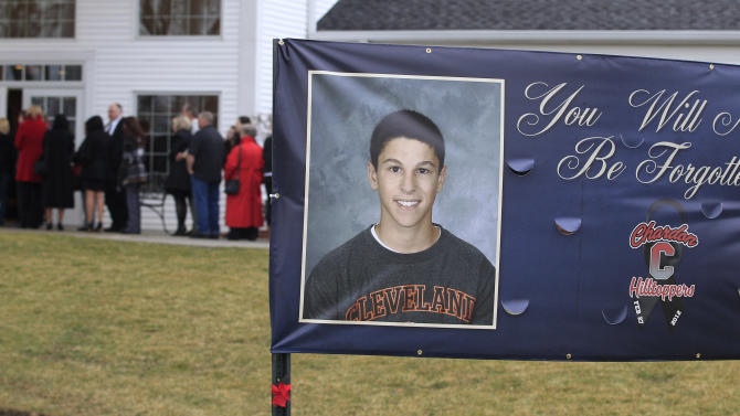 People line up outside of Monreal Funeral Home for calling hours for Daniel Permertor Friday, March 2, 2012, in Eastlake, Ohio. Parmertor and two others were fatally shot Monday at Chardon High School. Hundreds showed up for his wake at Monreal Funeral Home in Eastlake on Friday, the same day students returned to classes. (AP Photo/Tony Dejak)