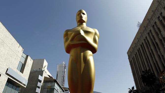 "FILE - In this Feb. 25, 2012 file photo, a Oscar statue is seen on the red carpet before the 84th Academy Awards in Los Angeles. The motion picture academy is honoring employees of film laboratories with an honorary Oscar statuette. The Academy of Motion Pictures Arts and Sciences said Wednesday, Jan. 8, 2014, other Scientific and Technical Awards recipients this year will include visual effects supervisor Peter W. Anderson and executive Charles ""Tad"" Marburg. Portions of the Scientific and Technical Awards presentations will be included in the Academy Awards broadcast on March 2, 2014. (AP Photo/Matt Sayles, File)"