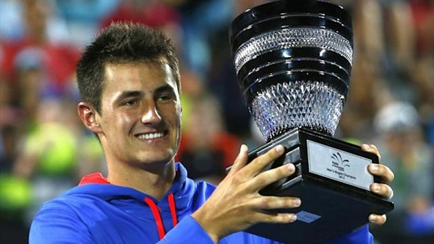 Bernard Tomic celebrates the ATP Sydney title (Reuters)