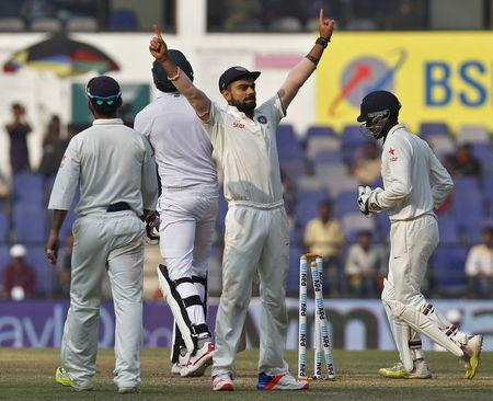 India's captain Kohli celebrates after their win over South Africa on the third day of their third test cricket match in Nagpur