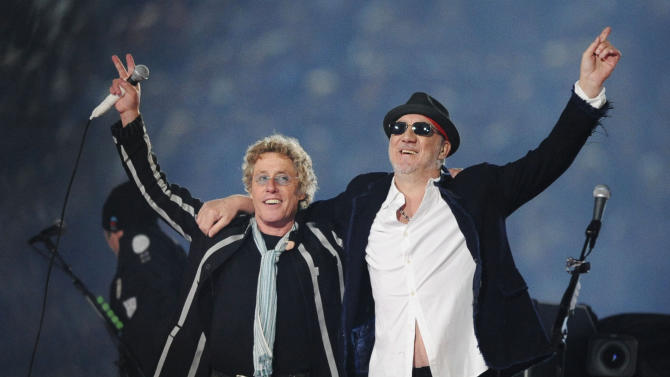 "FILE - In this Feb. 7, 2010 file photo, Roger Daltrey, left, and Pete Townshend acknowledge the crowd after performing during the second half of the NFL Super Bowl XLIV football game in Miami. Daltrey and Townshend are taking ""Quadrophenia"" and other Who classics on the road for a U.S. tour in fall 2012, but first plan what Daltrey calls a great finale for the Olympic Games in London. The Who tour kicks off in Sunrise, Fla., on November 1. (AP Photo/Mark J. Terrill, File)"