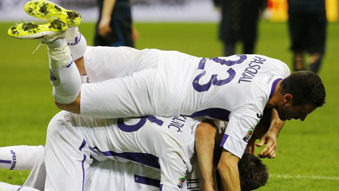 Fiorentina players celebrates after their Serie A soccer match against Inter Milan at San Siro stadium in Milan