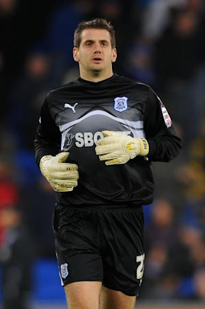 Goalkeeper Tom Heaton has signed for Bristol City