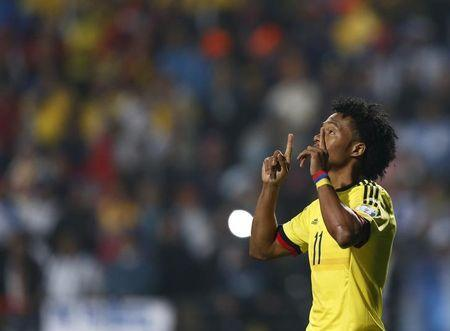 Colombia's Juan Cuadrado celebrates after scoring in penalties after the end of regulation play against Argentina in their Copa America 2015 quarter-finals soccer match at Estadio Sausalito in Vina del Mar