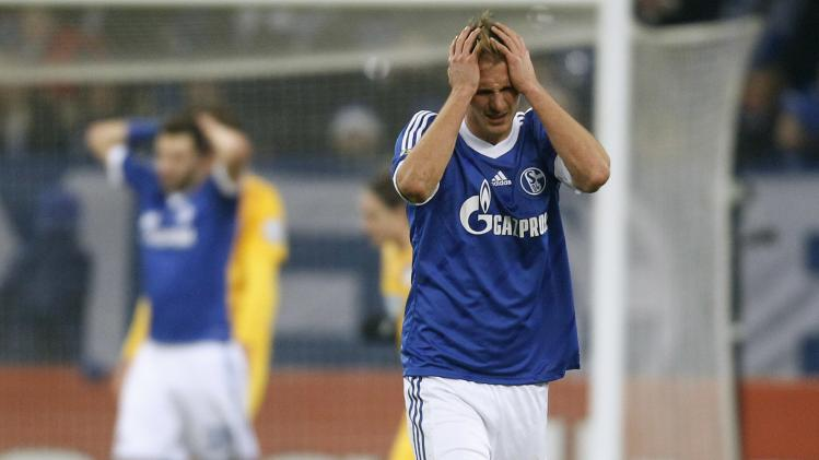 Schalke 04's Hoewedes reacts during their third round German soccer cup (DFB-Pokal) match against Hoffenheim in Gelsenkirchen