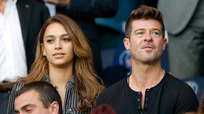 U.S. singer Robin Thicke and model April Love Geary attend the French Ligue 1 soccer match between Paris St Germain and Reims at the Parc des Princes stadium in Paris, France