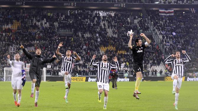Juventus' players acknowledge their supporters at the end of their Italian Serie A soccer match against Sampdoria at Juventus Stadium in Turin