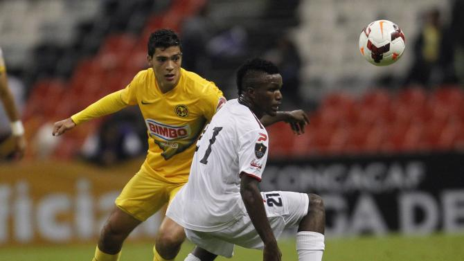 Alexander Gonzalez of Panama's Sporting San Miguelito challenges Raul Jimenez of Mexico's Club America during their CONCACAF Champions League soccer match at Azteca stadium in Mexico City