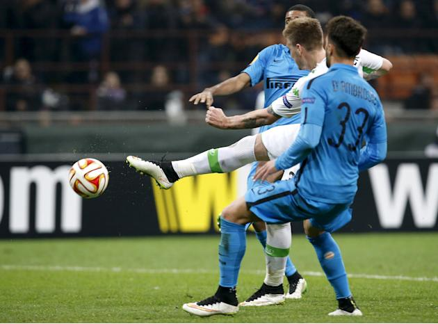 VfL Wolfsburg's Bendtner kicks to score a second goal against Inter Milan during their Europa League round of 16 second leg soccer match  in Milan