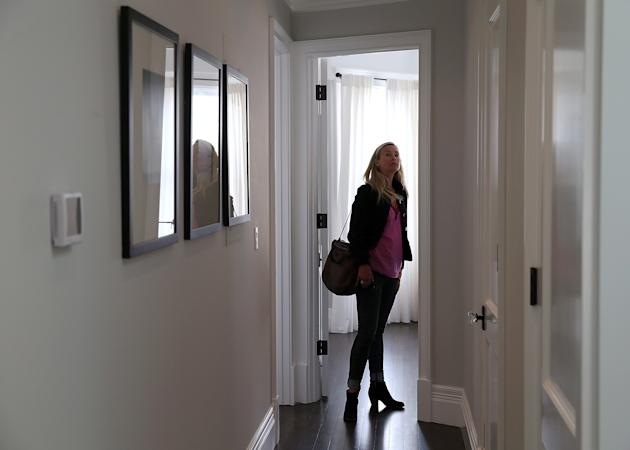 SAN FRANCISCO, CA - MAY 28: Stephanie O'Brien inspects a bedroom in a home for sale during an open house on May 28, 2013 in San Francisco, California. According to the Standard & Poor's Case-Shiller index, U.S. home prices surged 10.9 percent in March compared to one year ago, the largest gain since 2007. Phoenix, Arizona recorded the largest gains with prices spiking 22.5 percent and San Francisco, California was a close second with gains of 22.2 percent. (Photo by Justin Sullivan/Getty Images)