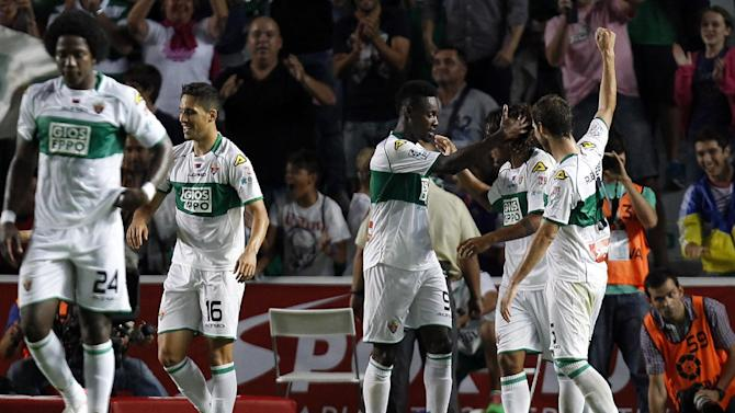 Elches's Richmond Boakye, center, celebrates after scoring against Real Madrid during their La Liga soccer match at the Martinez Valero stadium in Elche, Spain, Wednesday, Sept. 25, 2013