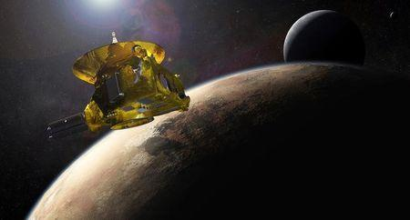 An artist?s impression of NASA?s New Horizons spacecraft encountering Pluto and its largest moon