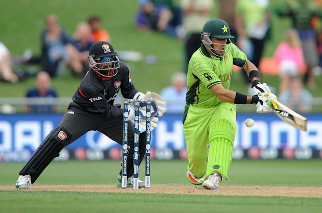 Pakistan's captain Misbah Ul Haq plays a shot as United Arab Emirates wicketkeeper Swapnil Patil watches during their Cricket World Cup Pool B match in Napier, New Zealand, Wednesday, March 4, 201