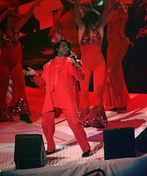 FILE -In this Sunday, Jan. 26, 1997 file photo, James Brown performs during the halftime show at Super Bowl XXXI between the Green Bay Packers and New England Patriots, in New Orleans. The South Carolina Supreme Court on Wednesday, Feb. 27, 2013, overturned a settlement divvying up the multimillion-dollar estate of James Brown, saying a former attorney general didn't follow the late soul singer's wishes in putting together the deal. (AP Photo/Mark Duncan, File)