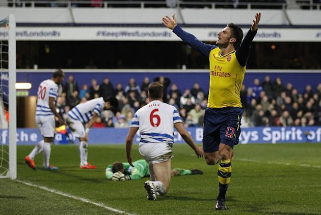 Arsenal's French striker Olivier Giroud celebrates scoring a goal during the English Premier League football match between Queen's Park Rangers and Arsenal at Loftus Road Stadium in London on March 4, 2015
