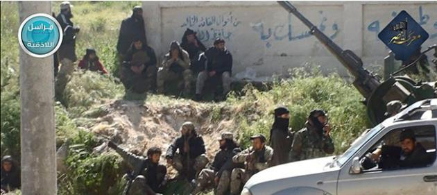 This image posted on the Twitter page of Syria's al-Qaida-linked Nusra Front on Saturday, April 25, 2015, which is consistent with AP reporting, shows Nusra Front fighters in the town of Jisr al-S