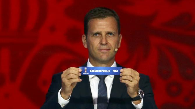 "Former German soccer player Bierhoff  holds up the slip showing the ""Czech Republic"" during the preliminary draw for the 2018 FIFA World Cup at Konstantin Palace in St. Petersburg"