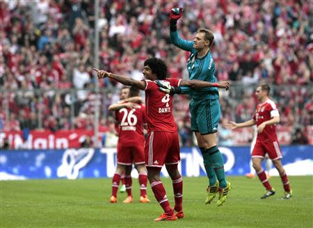 Bayern Munich's goalkeeper Neuer and Dante celebrate a goal during their German Bundesliga first division soccer match against Freiburg in Munich