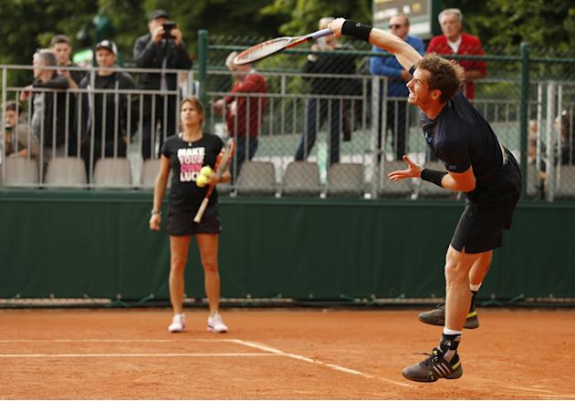 Tennis: Great Britain's Andy Murray during practice as coach Amelie Mauresmo (L) looks on