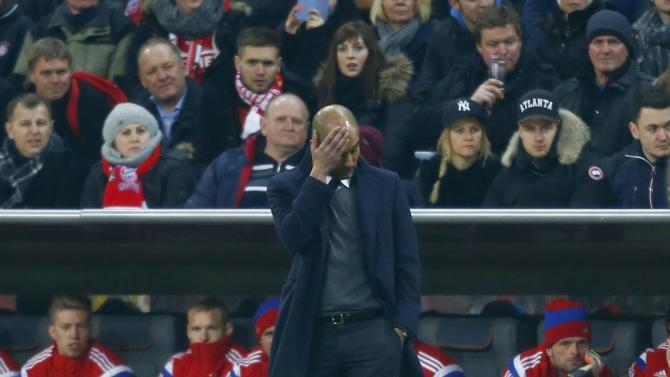 Munich's coach Guardiola reacts during his team's DFB Pokal soccer match against Braunschweig in Munich