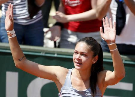 Andreea Mitu of Romania celebrates after beating Francesca Schiavone of Italy during their women's singles match at the French Open tennis tournament at the Roland Garros stadium in Paris