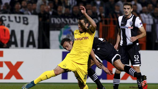 Borussia Dortmund's Mkhitaryan is challenged by PAOK Salonika's Berbatov during their Europa League group C soccer match at the Toumba stadium in the northern city of Thessaloniki