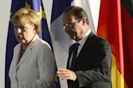 This file photo shows German Chancellor Angela Merkel and French President Francois Hollande, in Berlin, on August 23. The leaders of France and Germany meet on Saturday to mark a seminal 1962 speech by Charles de Gaulle, with the euro crisis and a proposed EADS-BAE merger also on the agenda
