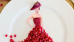 This food stylist recreated an iconic Jennifer Lawrence red carpet look with pomegranate seeds!