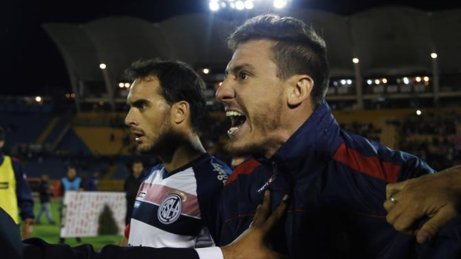 Argentina's San Lorenzo players shout at the referee after their Copa Libertadores soccer match against Ecuador's Independiente del Valle at Atahualpa Stadium in Quito