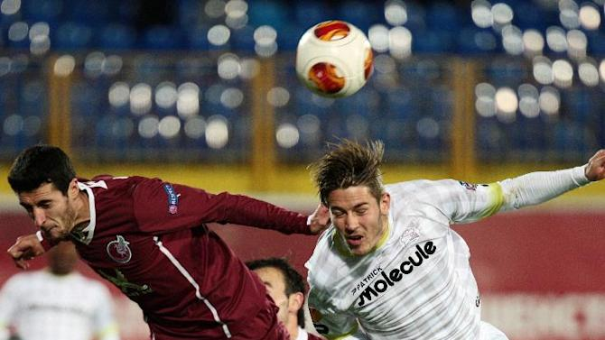 Rubin Kazan's Ivan Marcano, left, and Zulte Waregem's Olafur Skulason go for a header during their Europa League Group D soccer match in Kazan, Russia, Thursday, Oct. 3, 2013