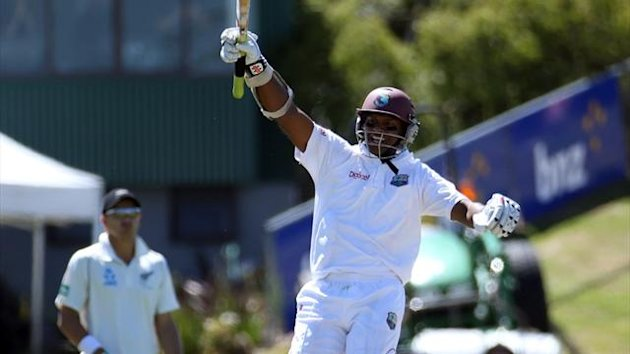 West Indian batsman Shivnarine Chanderpaul celebrates scoring a century against New Zealand (AFP)