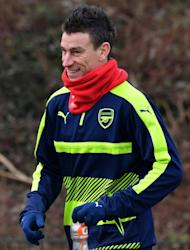 Arsenal's defender Laurent Koscielny arrives for a training session on the eve of their UEFA Champions League round of 16 1st leg football match against Bayern Munich, at Arsenal's London Colney training ground on February 14, 2017
