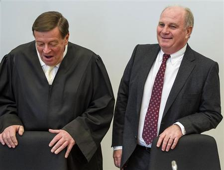 Bayern Munich President Uli Hoeness arrives with his lawyer Hanns W. Feigen (L) for the continuation of his trial for tax evasion at the regional court in Munich March 12, 2014. REUTERS/Marc Mueller/Pool