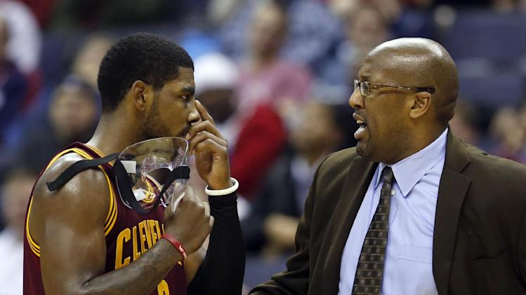 Cleveland Cavaliers guard Kyrie Irving (2) talks with head coach Mike Brown in the second period of an NBA basketball game against the Washington Wizards, Saturday, Nov. 16, 2013, in Washington. The Cavaliers won 103-96 in overtime