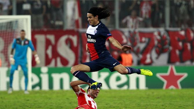 Andreas Samaris of Olympiakos, bottom and Edinson Cavani of Paris Saint Germain fight for the ball during the soccer Champions League group C match between Olympiakos and Paris Saint Germain in Piraeus, Greece, Tuesday, Sept. 17, 2013
