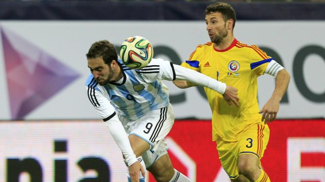 Argentina's Higuain challenges Romania's Rat Dinca during their international friendly soccer match at the National Arena in Bucharest