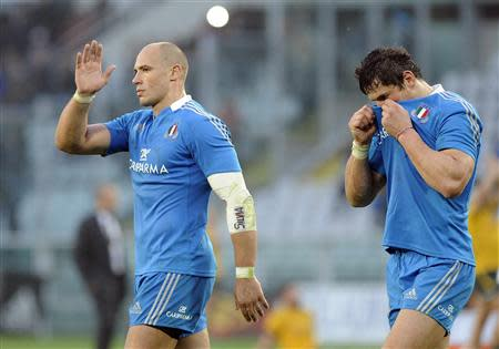 Italy's Sergio Parisse and Alessandro Zanni react as they leave the pitch after losing their Six Nations rugby union match to Australia at the Olympic stadium in Turin