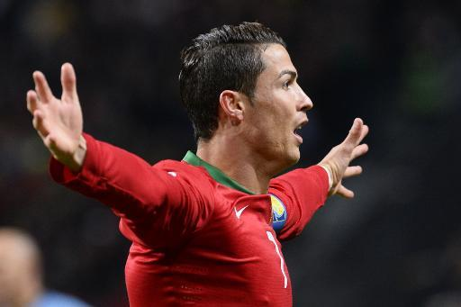 Cristiano Ronaldo celebrates after scoring for portugal against Sweden in the World Cup playoff at Solna, near Stockholm on November 19, 2013