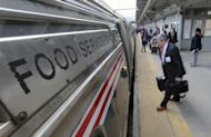 """Some of the 1,000 lobbyists, business owners and politicians rush to their assigned cars of the train taking them to Washington, D.C., Thursday, Feb. 16, 2017 in Trenton, N.J. The state Chamber of Commerce's 80th annual trip — nicknamed the """"Walk to Washington"""" because rail riders generally pace the train's corridors schmoozing and handing out business cards — comes after a national election that hinged in part on repudiating insiders and establishment politics. (AP Photo/Mel Evans)"""