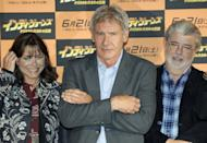 """Actor Harrison Ford (C) poses with actress Karen Allen and film producer George Lucas during the Toyko premiere of their film, """"Indiana Jones and the Kingdom of the Crystal Skull,"""" in 2008. A Belize archeologist is suing the makers of the fillm for using a likeness of a so-called Crystal Skull, which he says is a stolen national treasure"""