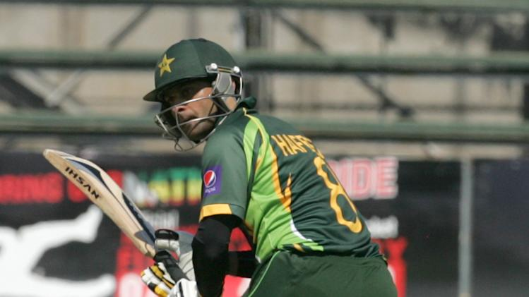 Pakistan batsman Muhammad Hafee bats during the 2nd game of the three match ODI cricket series between Pakistan and Zimbabwe at the Harare Sports Club on August 29, 2013.  AFP PHOTO / JEKESAI NJIKIZANA        (Photo credit should read JEKESAI NJIKIZANA/AFP/Getty Images)