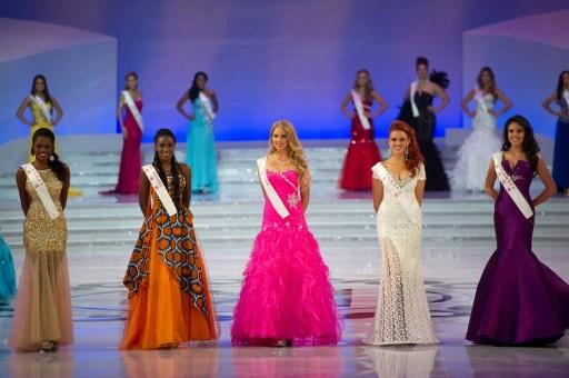 (From-L) Miss Gabon Marie Noelle Ada Meyo, Miss Cote d'Ivoire Hadjau Helene-Valerie, Miss Finland Sabina Sarkka, Miss France Delphine Wespiser and Miss Colombia Barbara Turbay pose during the Miss Wor