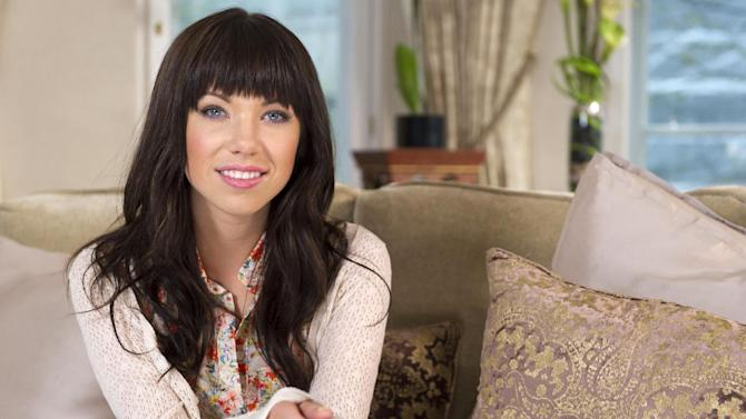This April 19, 2012 file photo shows Canadian singer, Carly Rae Jepsen in London. Jepsen has been tapped for the Annual Arthur Ashe Kids' Day at the U.S. Open. She'll join The Wanted, Owl City and Cymphonique Miller, along with reigning men's champion Novak Djokovic, past women's champion Kim Clijsters and John Isner. The Aug. 25 event, held at the Billie Jean King National Tennis Center in Flushing, N.Y., will feature performances as well as exhibition matches and other activities. (AP Photo/Jonathan Short, file)
