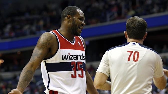 Washington Wizards forward Trevor Booker (35) talks with referee Brent Barnaky (70) in the first half of an NBA basketball game against the Los Angeles Clippers, Saturday, Dec. 14, 2013, in Washington