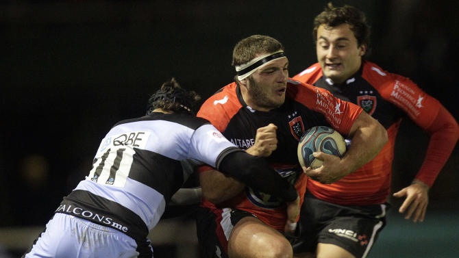 Newcastle Falcons' Ryan Shortland (L) tackles Toulon's Jean-Charles Orioli (R) during a pool 2, European Challenge Cup rugby union match at Kingston Park, Newcastle upon Tyne, England, on December 08, 2011. AFP PHOTO/GRAHAM STUART (Photo credit should read GRAHAM STUART/AFP/Getty Images)