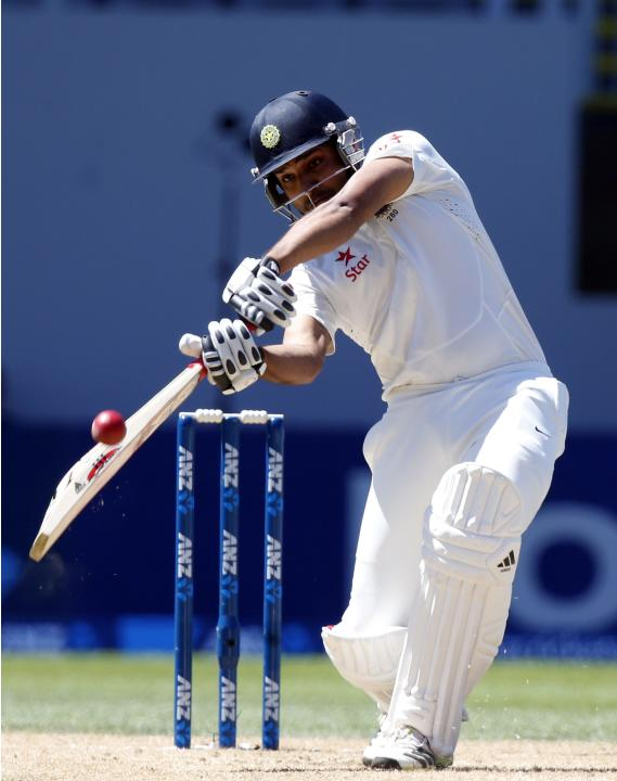 India's Rohit Sharma plays a shot during his second innings on day four of the first international test cricket match against New Zealand at Eden Park in Auckland