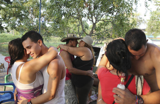 Couples dance at a park on the banks of an irrigation canal in Aracataca, the hometown of the late Nobel laureate Gabriel Garcia Marquez along Colombia's Caribbean coast on Friday, April 18, 2014.